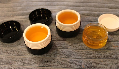 Containers with still warm balm