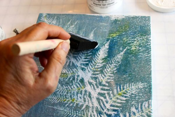 painting over the fabric on canvas