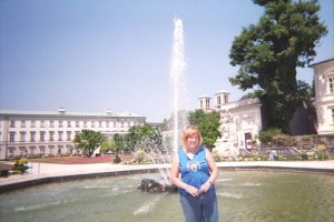 Lynda pauses for a moment in Mirabell Gardens. Photo taken in 2006.