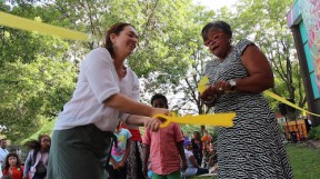 Parent Laura Flynn (L) and Principal Renee James (R) cutting the ribbon.