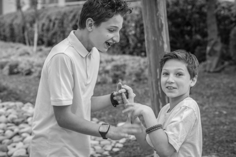 Two brothers being playful during their Crystal city family session