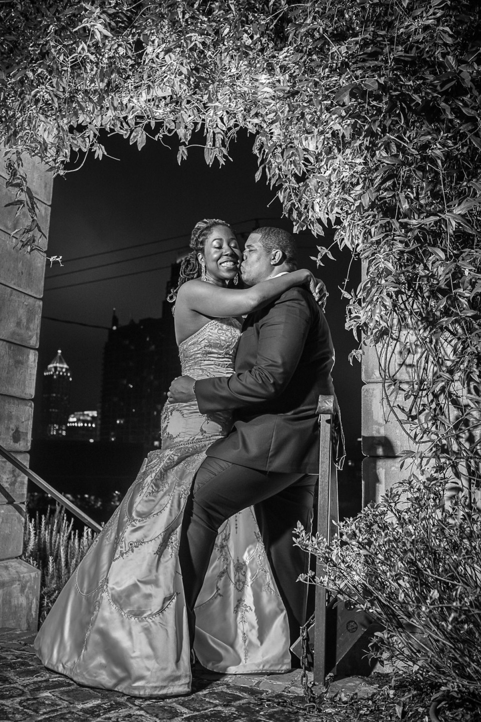 The bride and groom sharing a tender kiss during couple portraits