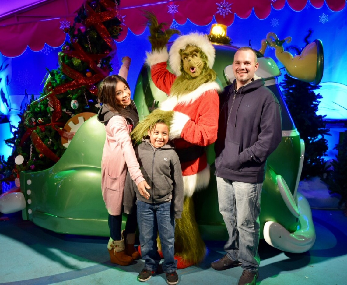I give thanks for Family--Image of family members posing with the Grinch
