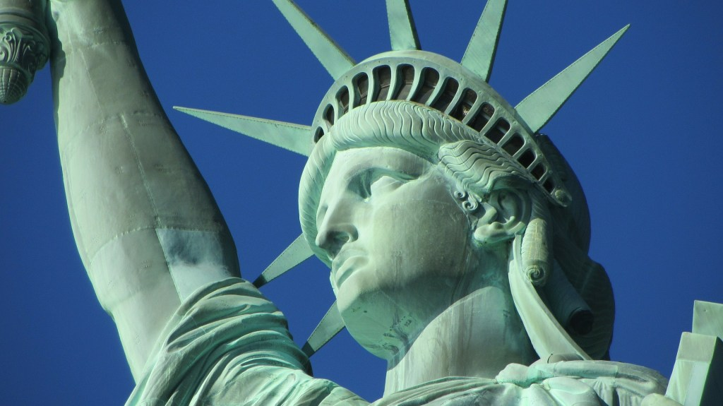 Photo of the face and head of the Statue of Liberty, a universal symbol of freedom and Democracy