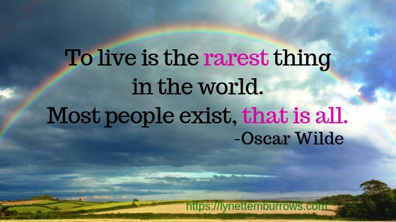"""A rainbow and quote. """"To live is the rarest thing in the world. Most people exist, that is all."""" Oscar Wilde"""