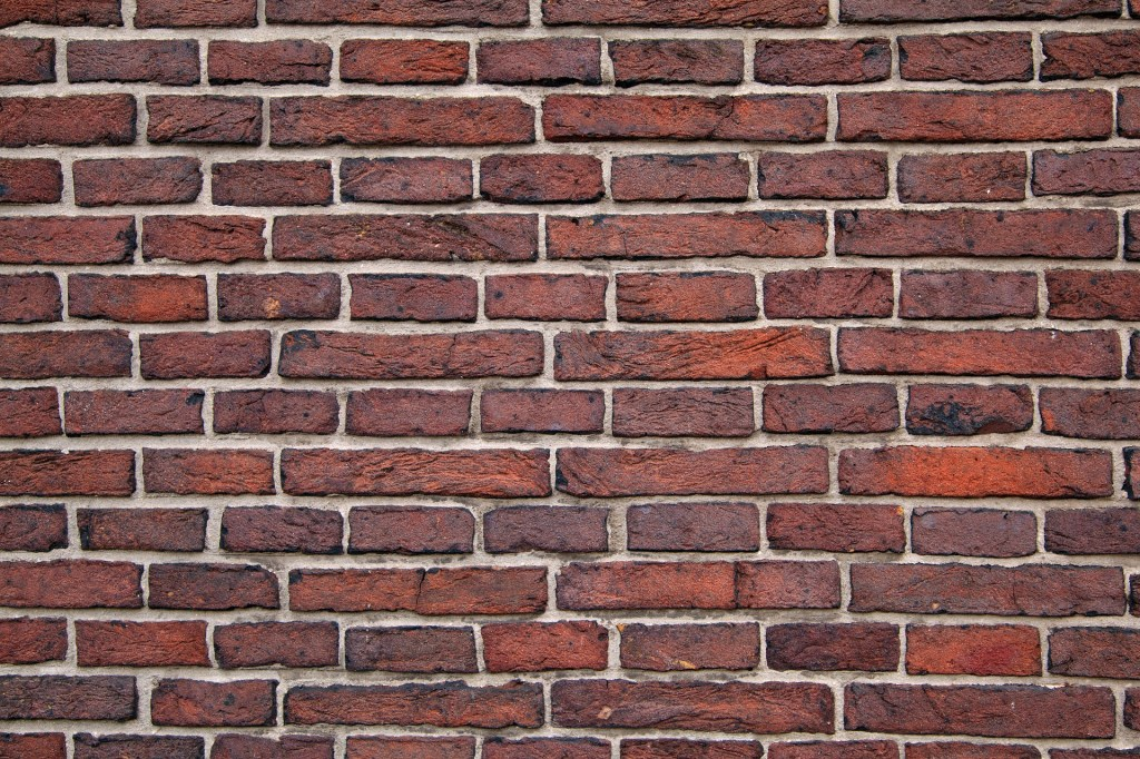 Image of a brick wall. Often that's how it feels but writer's block is not the end.
