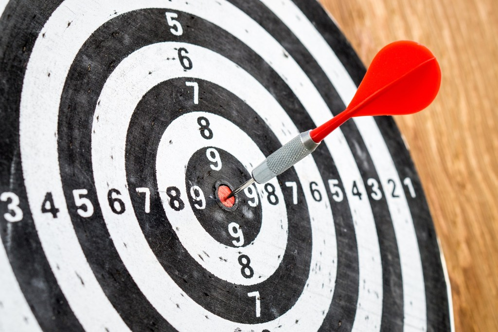 Image of a black and white target with a red dart perfectly centered on the red bull's eye but how do you know when you've hit a project's target? For long-term projects, progress is invisible unless you track it.