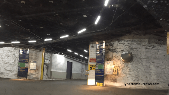 With a little help from my friends, I recently had a chance to tour this underground storage and warehouse cave.Image is of the caves rock walls at an intersection complete with signs directing you to different businesses.