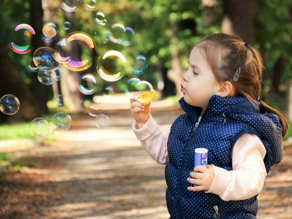Are we having fun? This little girl is blowing bubbles, when's the last time you had fun?