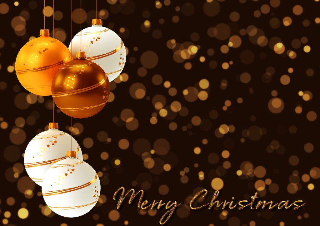 White and gold ornaments against a dark background with gold dots and the words Merry Christmas.