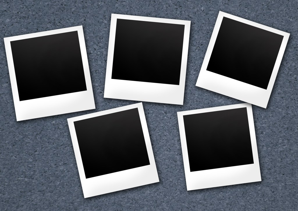 image of five polaroid pictures with without images. The black squares represent the lost portion of lost and found memories of trauma