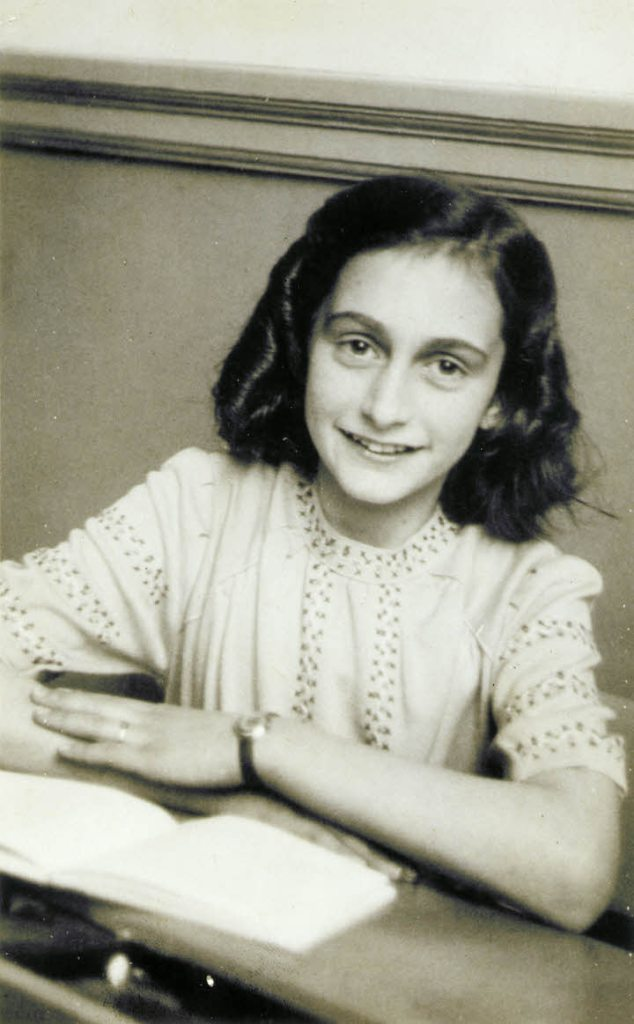 Image of smiling Anne Frank--in social isolation you don't have to be Anne Frank