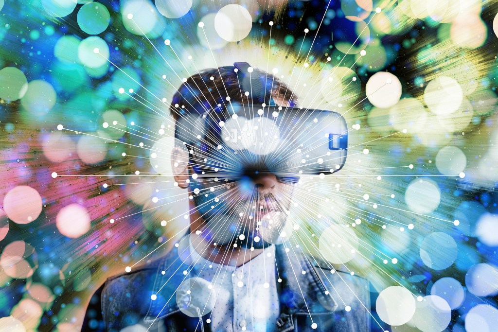 a man wearing cyber or VR glasses with a hazy field of bubbles around him.