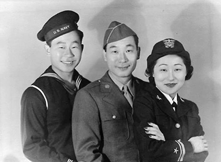 Image of Susan, the first Asian-American woman in the Navy, and her two brothers in their service uniforms.