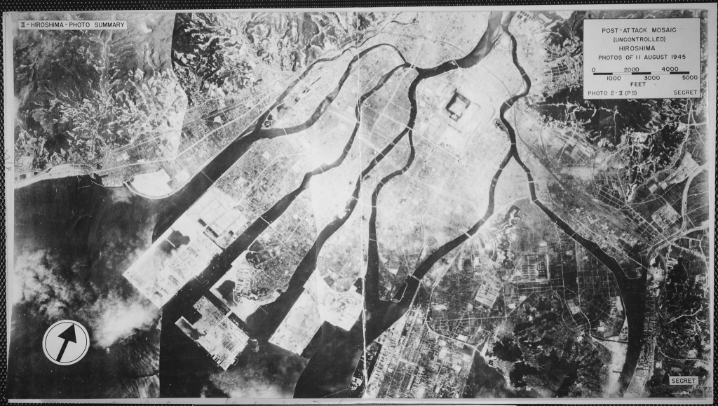 Post atom bomb view of hiroshima shows all the area between the rivers to be white--almost every structure and road obliterated.  Please pray for peace