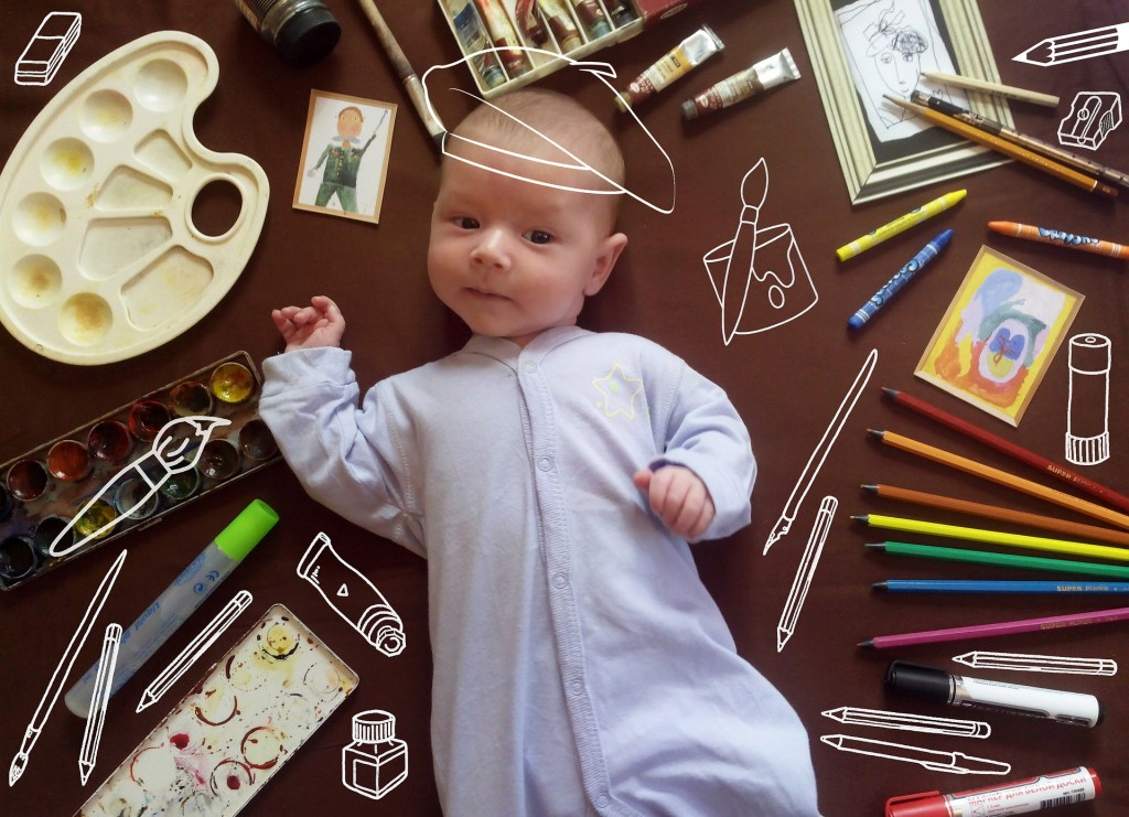 newborn baby with artists supplies around him--challenge these nine myths and reclaim your creativity