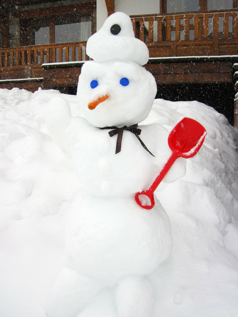 image of a snowman with blue eyes, a snow hat, and carrot nose. Do you know Frosty like I know frosty