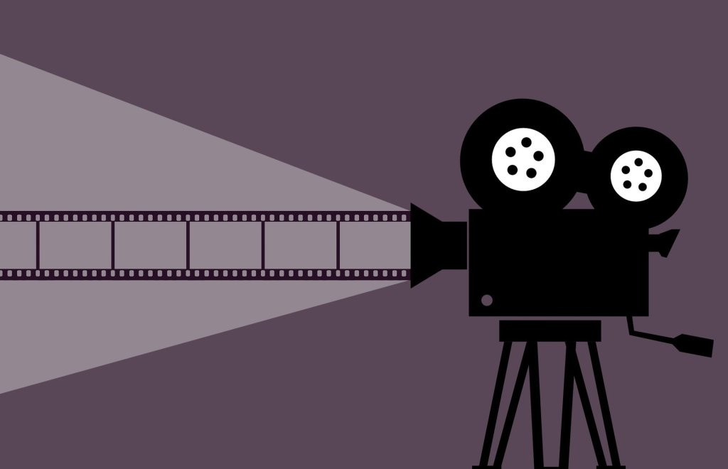 illustration of a reel-to-real movie camera--read great book, watch great movies