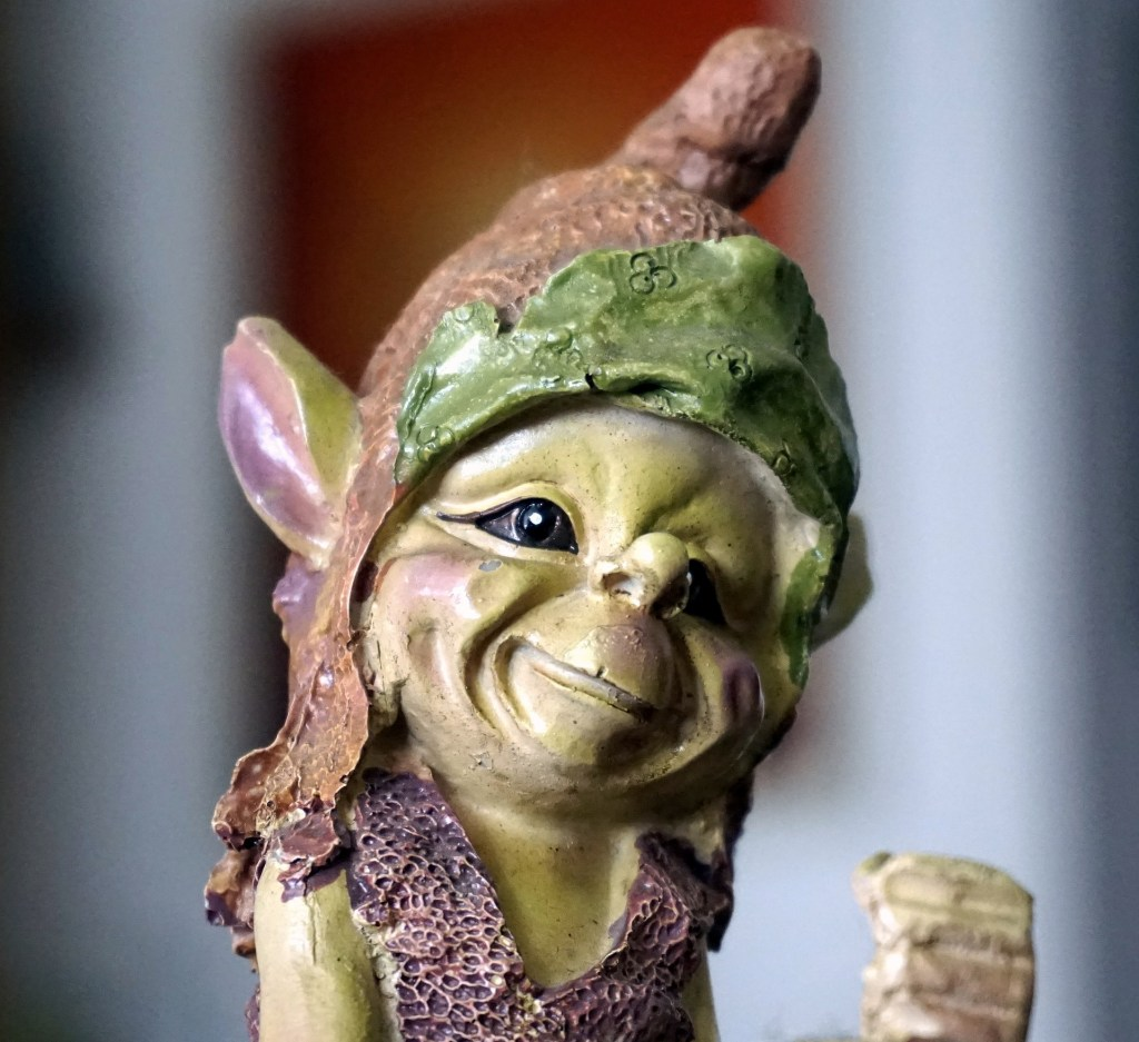 image of a gnome character with greenish skin and elf-like ears