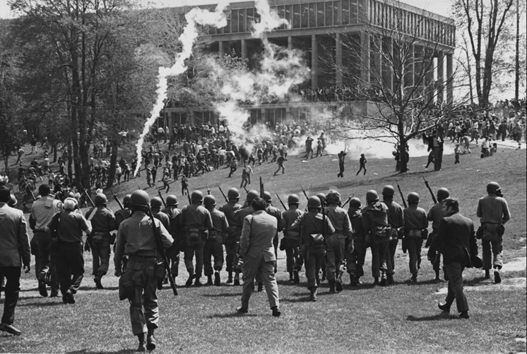 Image from behind National Guard Soldiers marching on students on the Commons at Kent State. May the fourth is more than a movie meme.