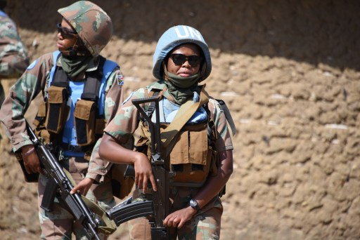 Photo of South African female combat troops with helmets, weapons, and in cammo