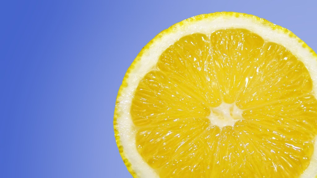 You Need a Well-Stocked I Can Do It Toolbox equipped with invigorating scents like this slice of fresh lemon on a blue background