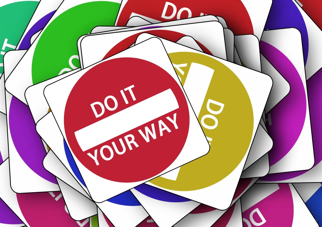 stack of square signs of colored circles with white letters saying Do It Your Way.