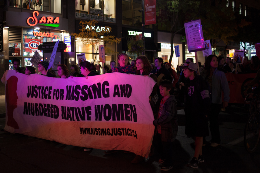 """Image of protest marchers at night holding a banner that reads """"justice for missing and murdered native women."""" where's your outrage?"""