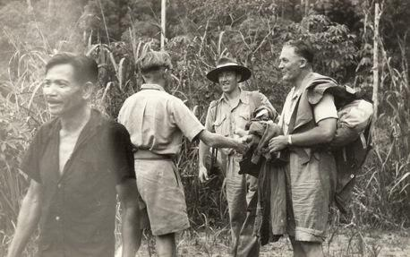 Harry Jackson, 2nd from right, and Kulang of Muanad village  who cut the track, far left.
