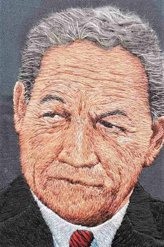 "Close up of Winston Peter's face in the embroidery piece ""Had Enough?"""