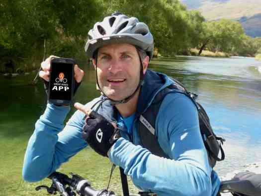 Gary Patterson with his cycle and phone using the Great Rides App