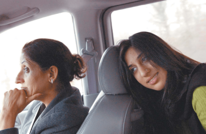 Monica Miglani and her mother, Rashmi, on their way to Monica's interview at Suffolk University, in Boston.Monica was nervous. Her father, Vinod, drove. The Providence Journal / Gretchen Ertl