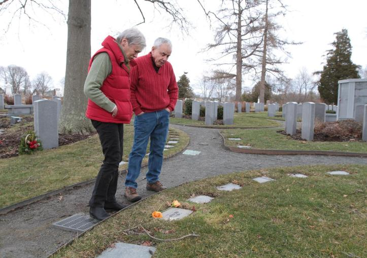 """Susan Terhune and John Cabral visit the graves of their son, Eric Cabral, on the one-year anniversary of his death. """"The system is broken,"""" John Cabral said last week. """"Until they look at [addiction] as a social problem, not a criminal problem, it's just going to get worse."""" Journal files/Sandor Bodo"""