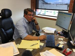 Stephen DelSesto, receiver for St. Joseph's pension plan, returns calls from worried retirees in his Providence law office. CREDIT LYNN ARDITI / RIPR