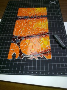orange mosaic ammonite fossil work-in-progress by Lynn Bridge