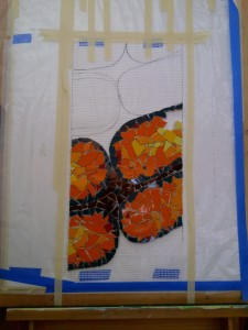orange ammonite fossil mosaic work-in-progress by Lynn Bridge
