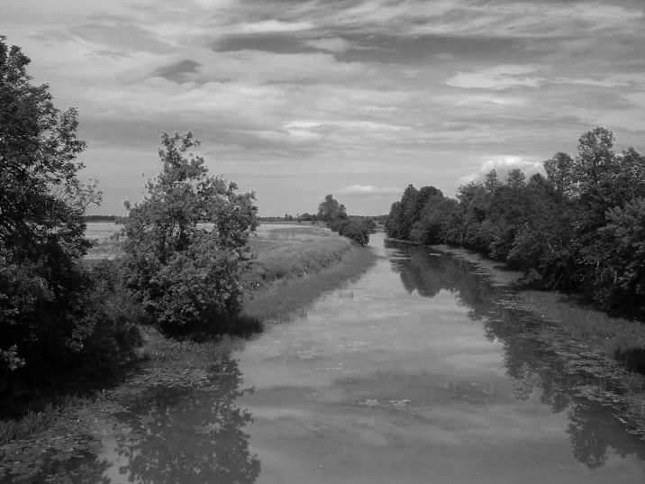 river and pastures and sky black and white