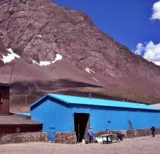 workers by shed in Andes mountains