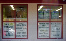 signs in grocery store window
