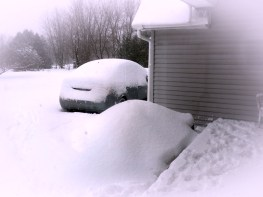 heavy snowfall covering car