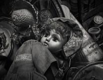flea market still life black and white doll