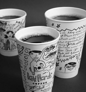 Paper coffee cups with writing on them