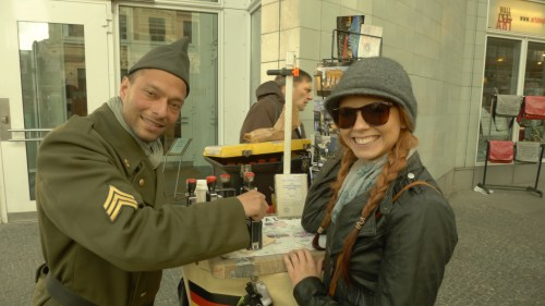 Getting my novelty passport stamp at Checkpoint Charlie