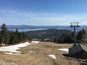 Looking out over Lake Winnipesaukee (and Upper Trigger ski run) from the top of Gunstock.