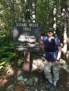 At the start (note the short sleeves). Also note the misspelling of Carrigain not once, but twice, at the bottom of the sign. I hadn't even noticed until a fellow NH Women's Hiking Group member on Facebook mentioned it.
