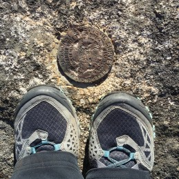 This USGS benchmark on the Belknap Mountain summit is mislabeled as Gunstock. I have heard that Gunstock may have been the name of both peaks sometime in the past, and that may be the reason why.