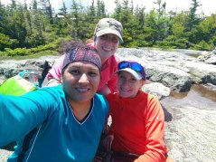 Lucy and Devon, with me in the middle, at the summit.