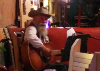playing the guitar - J. Michael Combs