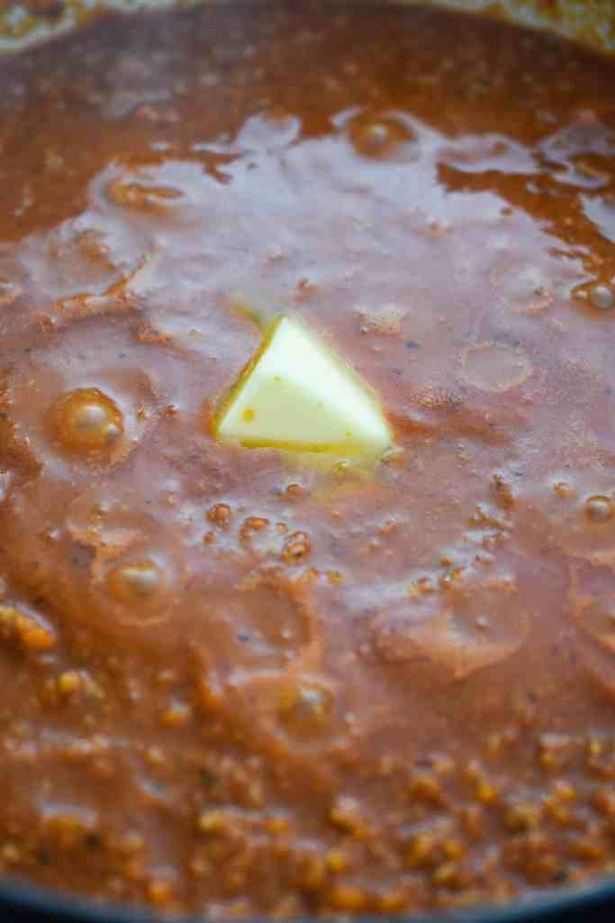 Melting Butter Into the Bolognese Sauce