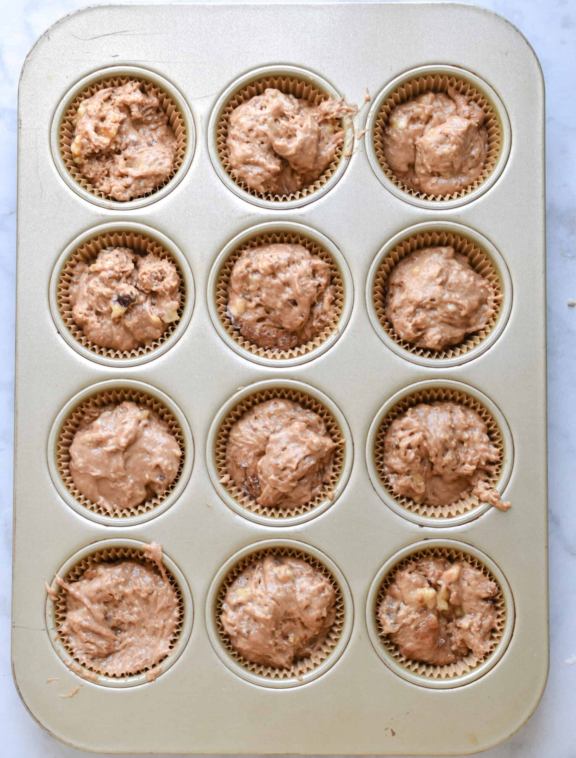 Fill the muffin tins with the batter
